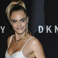 Cara Delevingne flashes midriff at DKNY birthday party