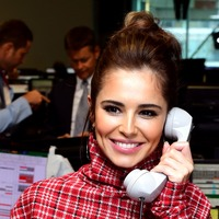 Cheryl stands out in tartan on 9/11 charity day