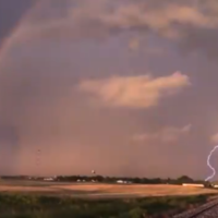 Lightning strikes inside rainbow in 'special' footage