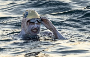 American woman becomes first person to swim across Channel four times non-stop