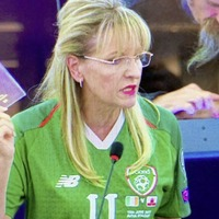 Sinn Féin MEP Martina Anderson wears James McClean's Ireland jersey during EU debate