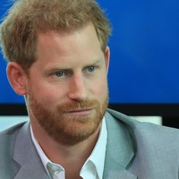 BBC apologises to Duke of Sussex for showing image branding him 'race traitor'