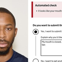 Passport photo checker falsely flags black man's lips as open mouth