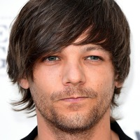 Louis Tomlinson says 'dark side' of life has made him stronger