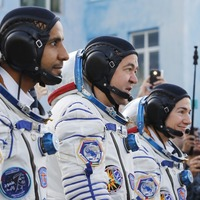 Multinational crew docks at International Space Station