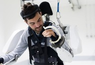 Tetraplegic man walks using mind-controlled exoskeleton