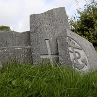 Extra security measures for west Belfast cemetery after graves attacked