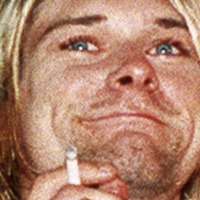 Kurt Cobain's guitar and Unplugged sweater head to auction