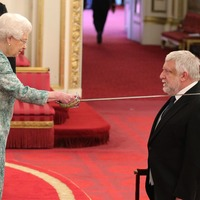 Sir Simon Russell Beale 'a bit giggly' as he collects knighthood