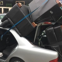 Driver caught with sofas and chairs piled on car roof