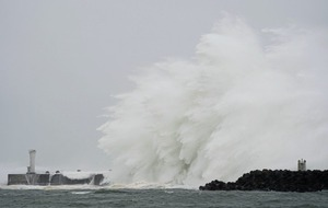 Death toll rises as Typhoon Hagibis pounds Japan