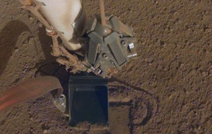 Mars lander's digger is burrowing again after setback