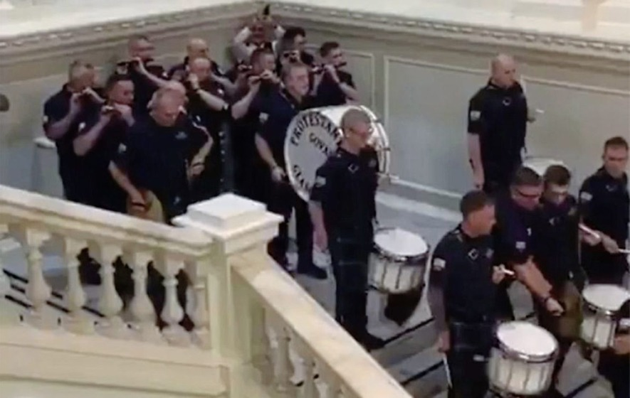 Orange lodge apologises after loyalist flute band parade in Belfast City Hall