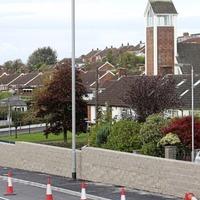 Work halted on Saintfield Road wall amid height row