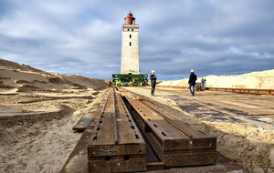 Century-old lighthouse placed on wheels to move it away from eroding coastline