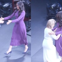 Meghan shares awkward curtsy-hug with founder of One Young World at summit