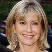 Olivia Newton-John has no regrets over auctioning off her career memorabilia