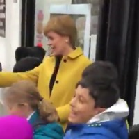 Nicola Sturgeon dances in the rain with school pupils