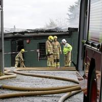 West Belfast carpet warehouse arson attack 'despicable'