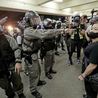 Riot police storm shopping centres in Hong Kong to thwart pro-democracy protests
