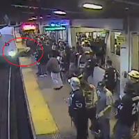 'Hero' rail worker pulls man from tracks one second before train arrives