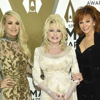 Dolly Parton, 73, wows on awards show red carpet