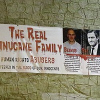 Police attend as banner attacking family of Sinn Fein candidate John Finucane is removed