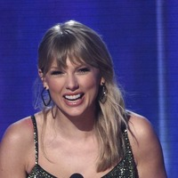 Taylor Swifts toasts her fans as she is named artist of the decade