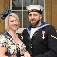 Naval engineer proposes to partner at Buckingham Palace after receiving MBE