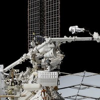 Spacewalkers carry out maintenance on cosmic ray detector
