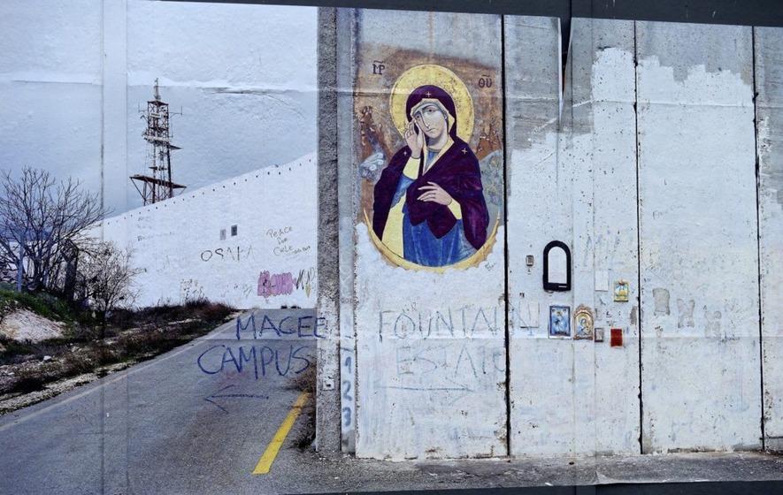 Loyalist graffiti painted on peace wall photo exhibition