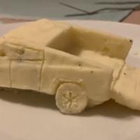 Man makes 'mash-terpiece' model of Tesla with Thanksgiving mashed potatoes