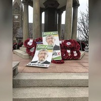 War memorial vandalised in Lurgan - election posters dumped on poppy display