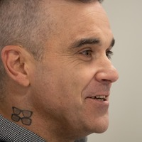 Robbie Williams stokes Liam Gallagher feud with chicken imitation