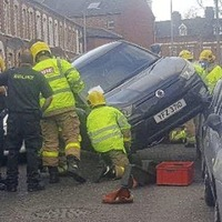 Woman freed after crash wedges car in Holyland street