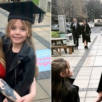 Mother who gave birth as teenager graduates holding daughter's hand