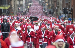 In Pictures: Dashing through the streets as Santas run for charity
