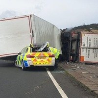 Policeman requests road closure as 'lorry has just toppled on to my patrol car'