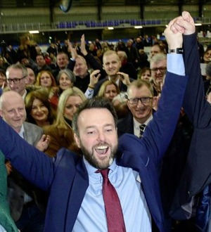 SDLP leader Colum Eastwood protests against swearing allegiance to Queen Elizabeth
