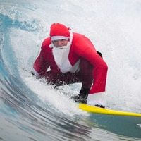 Surfing Santa hits the waves