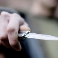 Knife-wielding robber holds up off-licence