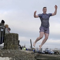 Hundreds brave chilly waters for New Year's Day swims