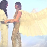Abbey Clancy appears as harp-playing angel in The Darkness music video