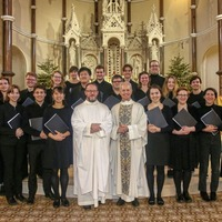 Cambridge University choir perform for Mass goers in Belfast city centre