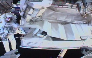 Spacewalking astronauts fix leak in cosmic ray detector