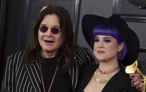 Ozzy Osbourne walks the Grammys red carpet with a cane