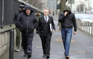 Jamie Bryson wore a Union flag tie to court and was accompanied by loyalist supporters
