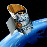 Two defunct satellites narrowly avoid colliding in space