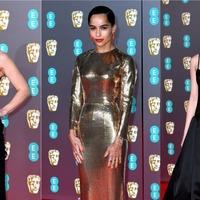 Sleek black dresses and bursts of metallics rule on subdued Bafta red carpet