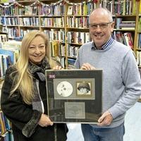 Close friend of U2 donates band memorabilia to Co Down charity shop